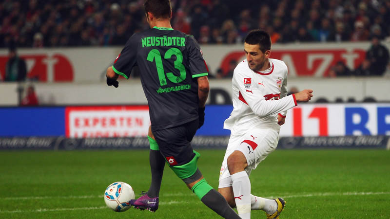STUTTGART, GERMANY - JANUARY 29: Vedad Ibisevic (R) of Stuttgart is challenged by Roman Neustaedter of Moenchengladbach during the Bundesliga match between VfB Stuttgart and Borussia Moenchengladbach at Mercedes-Benz Arena on January 29, 2012 in Stuttgart, Germany. (Photo by Alex Grimm/Bongarts/Getty Images)