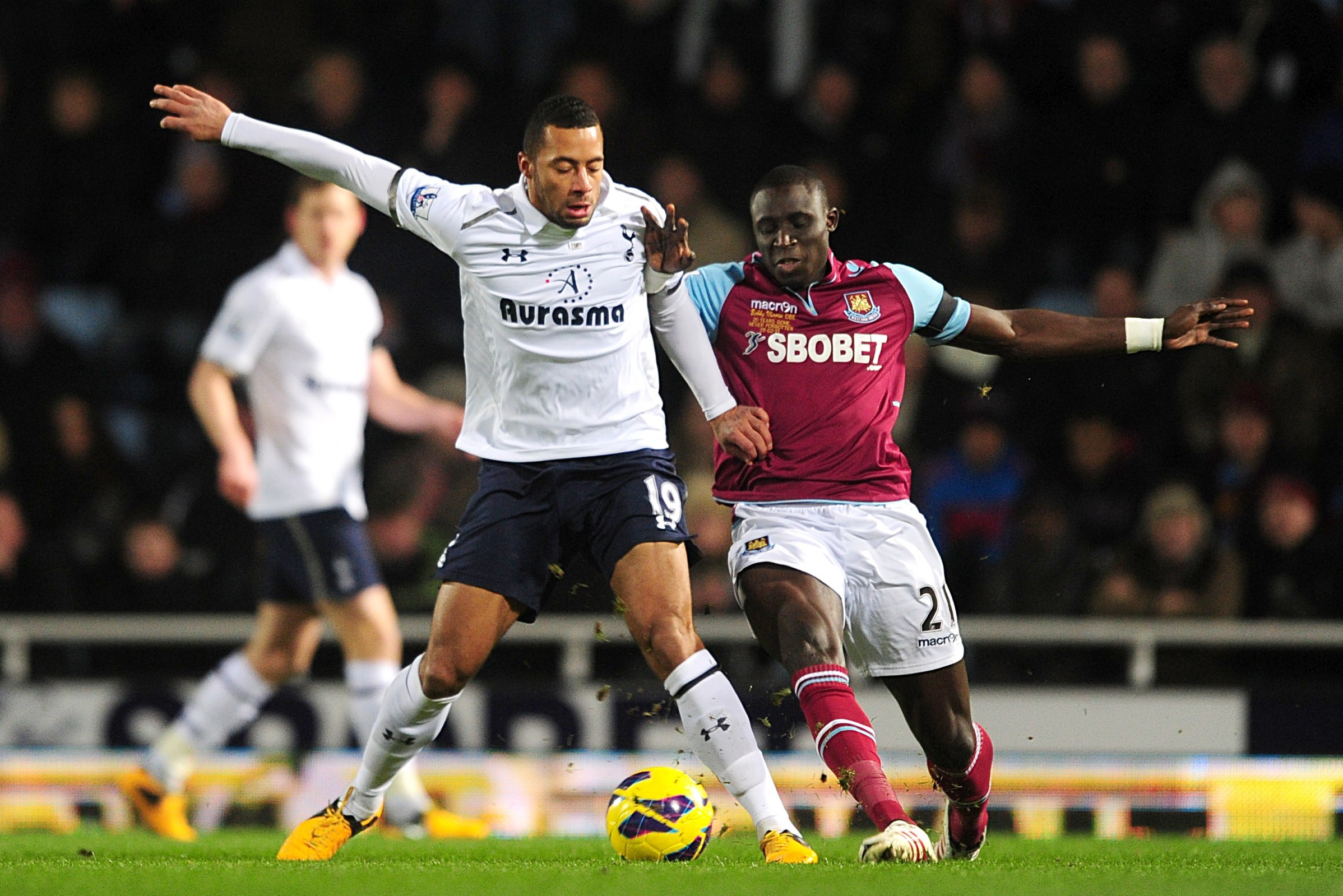 Tottenham Hotspur's Mousa Dembele (left) and West Ham United's Mohamed Diame (right) battle for the ball during the Barclays Premier League match at Upton Park, London. PRESS ASSOCIATION Photo. Picture date: Monday February 25, 2013. See PA story SOCCER West Ham. Photo credit should read: Adam Davy/PA Wire. RESTRICTIONS: Editorial use only. Maximum 45 images during a match. No video emulation or promotion as 'live'. No use in games, competitions, merchandise, betting or single club/player services. No use with unofficial audio, video, data, fixtures or club/league logos.